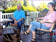 David and Michela McMahon relaxing on their back porch with 3-year-old Akita mix named Buddy Guy. (Judy Nelson/Star-News)