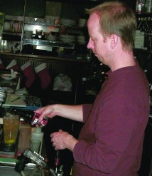 Tim Williams behind the bar at Peters Bar and Grill. (Phill Colombo)
