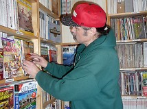 AJ Jones has worked with resale publications for two decades. He keeps special issues near the cash register. The shop is lined with neatly labeled shelves holding magazines from the early 1900s to last month. (Janet Goetze)