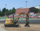 Construction workers are moving their equipment at Madison High School south of the track and football field toward the baseball field. The overhaul is one of four Portland Public Schools outdoor athletic facilities being renovated this summer. Other work is being done at Jefferson, Wilson and Marshall high schools. (Phill Colombo)