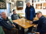 A group of friends gather to play a card game called Pitch in the lounge of the Rose City Park golf clubhouse. The clubhouse serves as a comfortable gathering spot. (Judy Nelson)