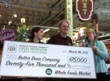 Hannah and Keith Kullberg, left, are presented with a $75,000 check by Denise Breyley, Whole Foods Market's Local Forager, during an event at the natural grocers Hollywood store. (Ted Perkins)