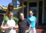 Marshall Runkel and his family outside their North Portland home along with their contractor. (Clean Energy Works)