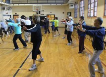 Older adults take part in Tai Chi: Moving for Better Balance, a class held at the Northeast Community Center. (Northeast Community Center)