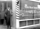 This photo was taken outside of the Roseway Barber Shop's building in 1915 or 1916. The space has operated as a barber shop for 100 years and will be celebrating a centennial anniversary this month. (Roseway Neighborhood Association/Thomas Robinson Collection)