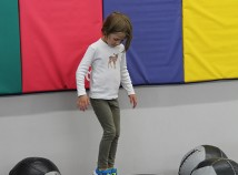 A child enjoys jumping at the Northeast Community Center's new Annex. (Vicki Penfield)