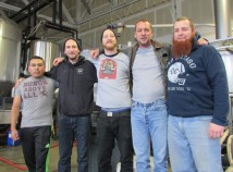 Carlos Lopez, left, Eric Rolerkite, Alaric Lawrence, Matt Schumacher and Chris Jennings take a break from shipping at Alameda Brewing Company's Southeast Portland production facility. (Ted Perkins)