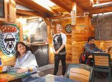 On the back patio of Rose and Thistle Pub, 2314 N.E. Broadway, co-owner Kyra Rodgers is ready to serve customers Gina Rentz and Nicholas DuBois, who are Northeast Portland residents. The Pub celebrates 22 years in business in August 2014.