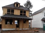 FEB 5 – Two of three two-story homes being built at 3934 N.E. 66th Ave. are nearing completion. Last summer, Everett Custom Homes demolished the single-family house that previously occupied the property and began construction. (Phill Colombo)