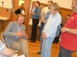 Metro District 5 Councilor Sam Chase answers neighbor's questions about the involvement of the regional government in development. Chase spoke to a group of just under 100 participants in a charrette organized by the Broadway-Weidler Alliance in mid-May. (Phill Colombo)
