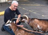 On Bacchis last day of business in Roseway, neighbor Erica Somes brought her familys goats by the deli to say farewell to owner Mark Caso. (Erica Somes)