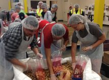 Logical Position employees bag potatoes while volunteering at the Oregon Food Bank. (Logical Position)