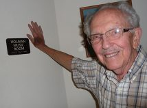 Frank Holman has retired after 40 years as music director at Rose City Park United Methodist Church. The rehearsal room is named the Holman Music Room, with appropriate plaque. Holman jokes that he got the plaque instead of a raise one year. (Janet Goetze)